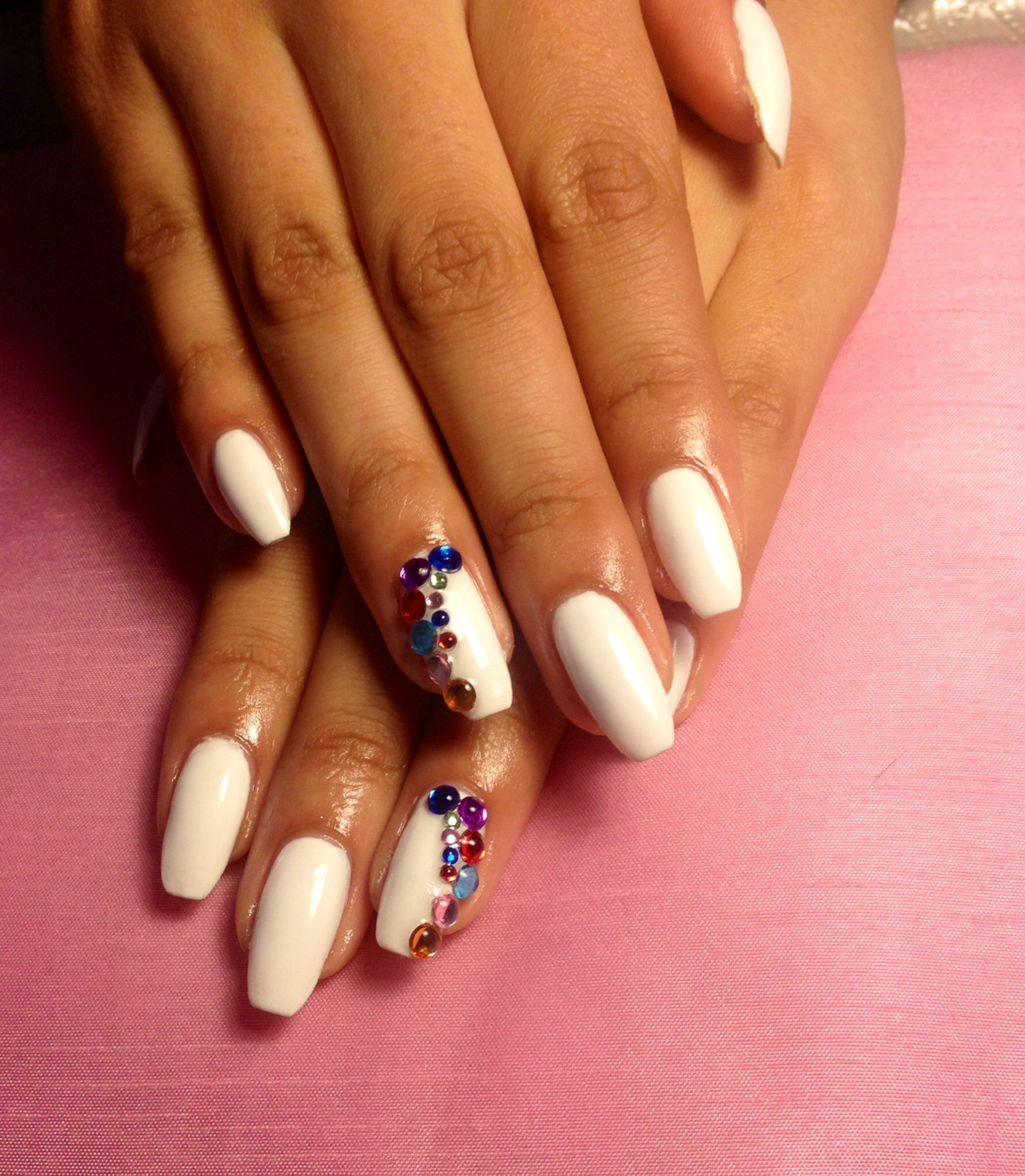 Gel overlay on natural nails white with multicolour rhinestones ...