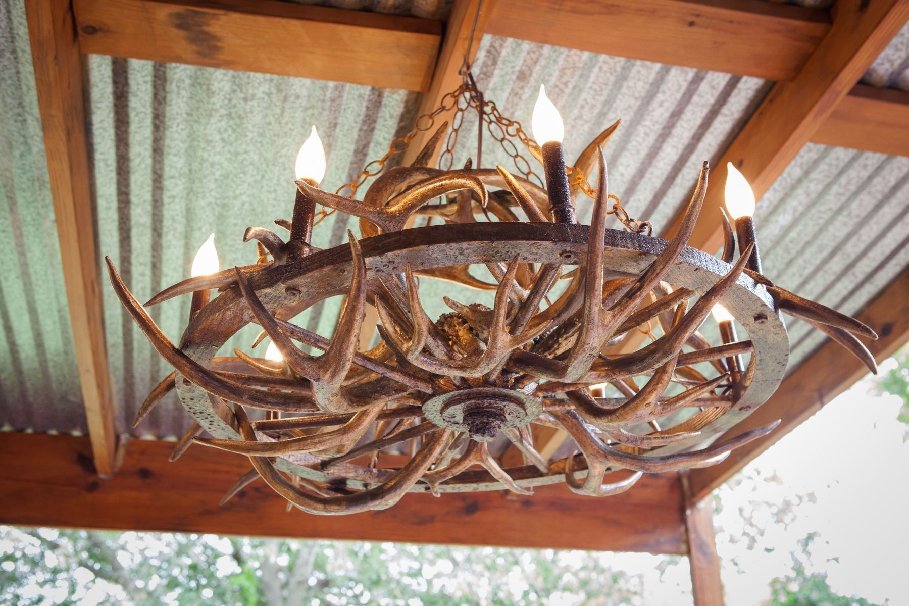 Custom made beautiful unique handmade art aged gold antler wagon custom made beautiful unique handmade art aged gold antler wagon wheel chandelier mozeypictures Image collections