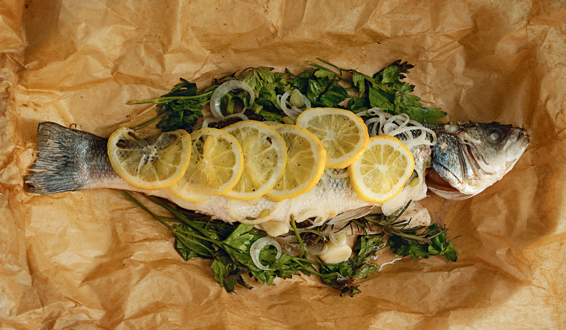 Recipe: Sea Bass baked in a package : To celebrate 10 years since it was first published, Phaidon's now cult-followed 'The Silver Spoon' recipe book is back with a quick and easy version. Here, this recipe, and three others to follow, show how delicious Italian cuisine can be prepared in under 30 minutes.