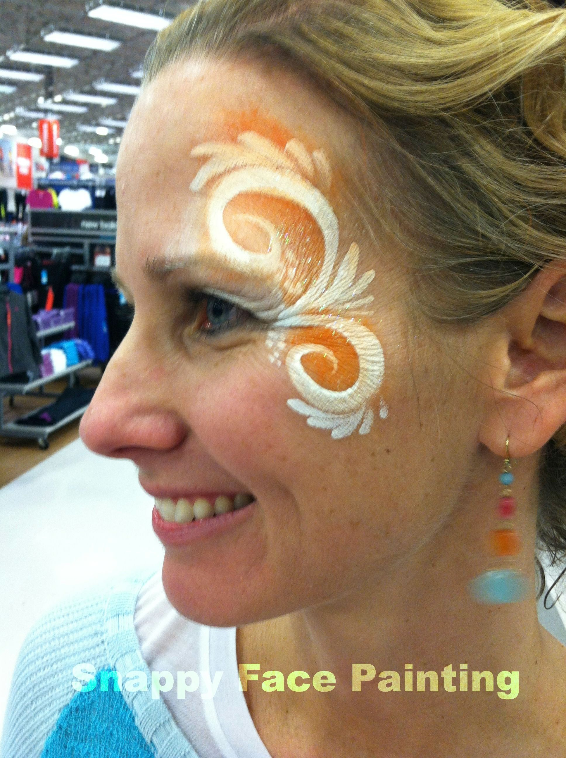 Fancy Swirls For Girls With Orange And White Face Paint To