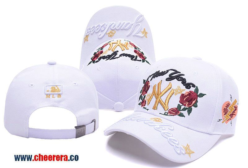 20d207118e0 MLB New York Yankees Adjustable Snapback Hat in White with Flower Stitches