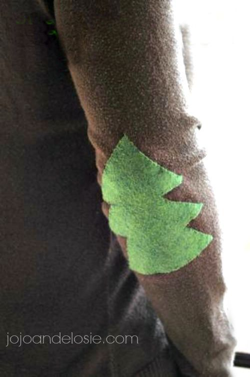 Who doesn't LOVE a good elbow patch? I know I do, and what better way to get into the Season with a Christmas Tree Patch. I used an old sweater from my closet and some green felt I had on hand. Start off by putting your Sweater on and with a piece of chalk mark …