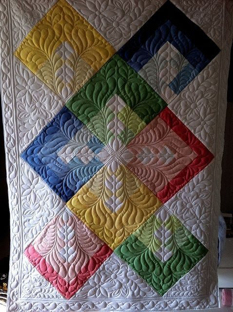 Lots of ideas here. Love the feather quilting design she used. It brought this quilt to life.   http://www.flickr.com/photos/jessicasquiltingstudio/