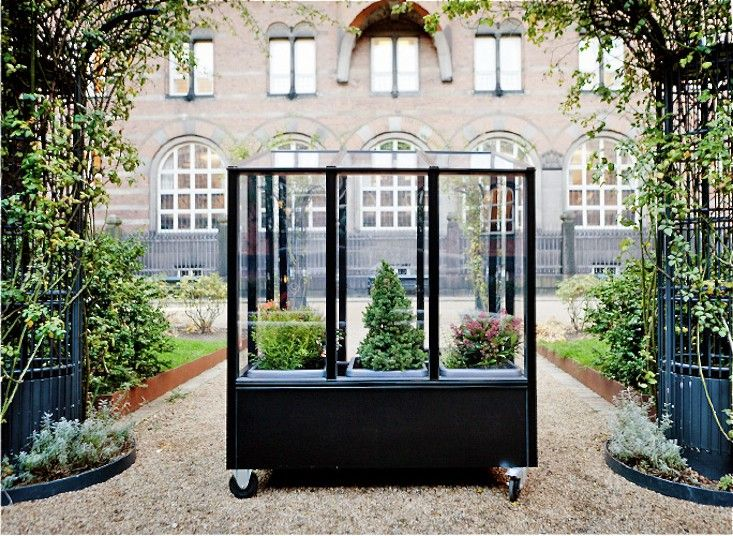 Small Space Gardening A Tiny Greenhouse On Wheels Gardenista Small Space Gardening Urban Garden Greenhouse