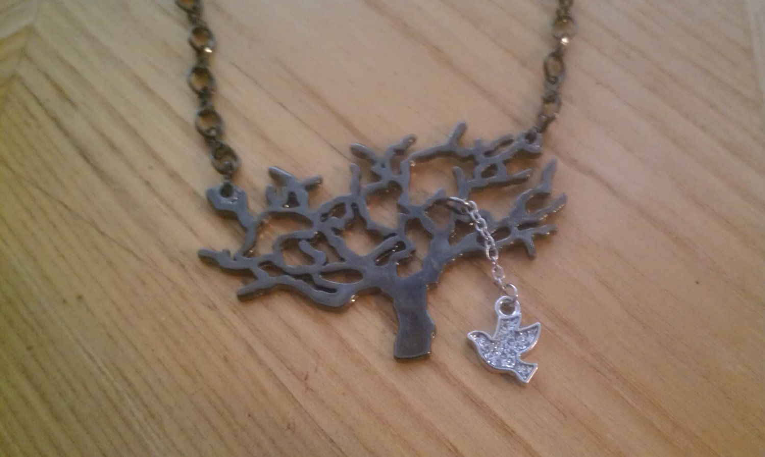 Bird and Tree Necklace. 10.00, via Etsy. (With images