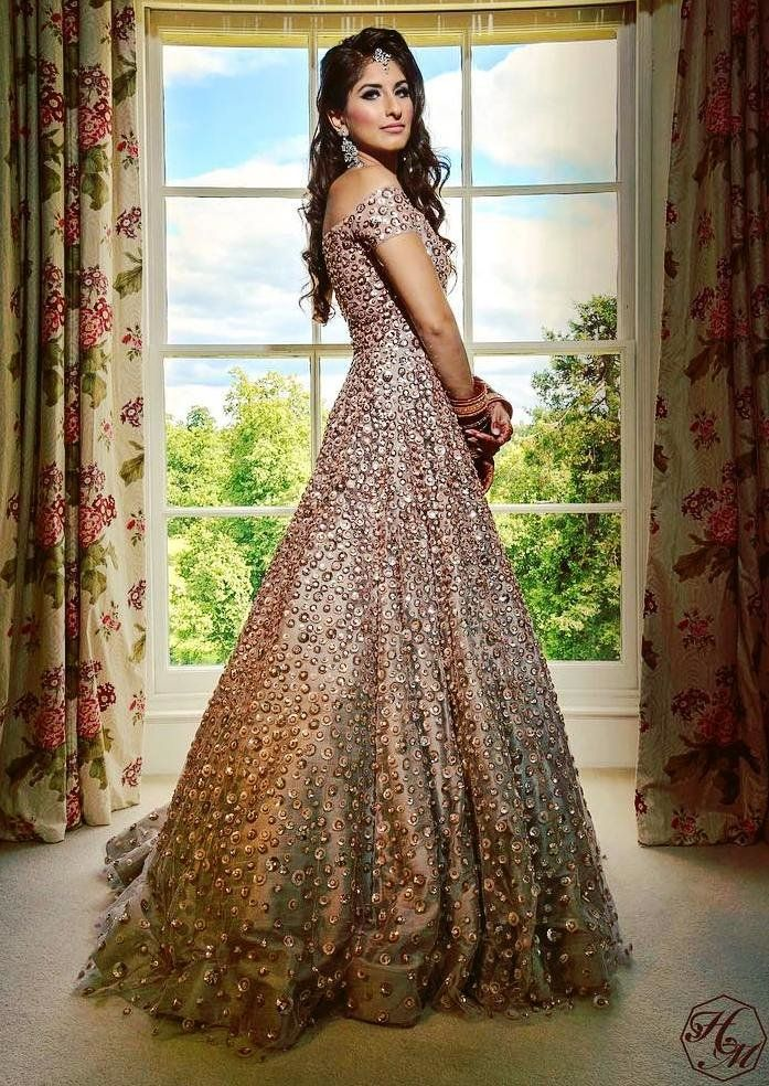 dbf0faf5a59 How stunning does this bride look in a largely flared evening gown