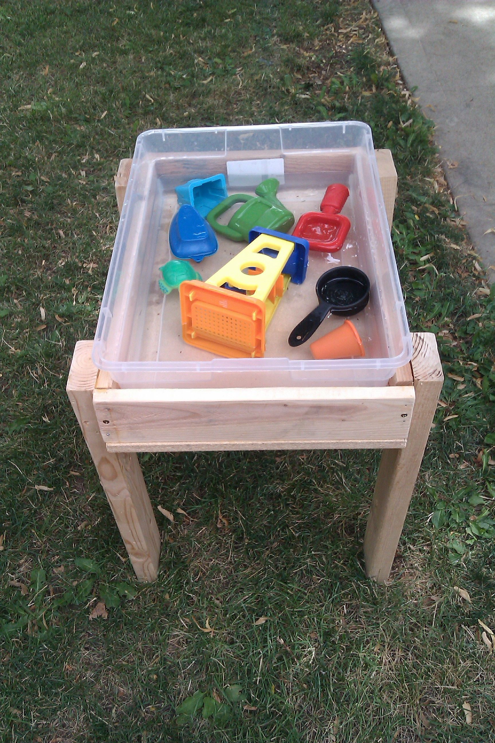 Water table idea easy to clean and stores toys for for Diy sand and water table pvc