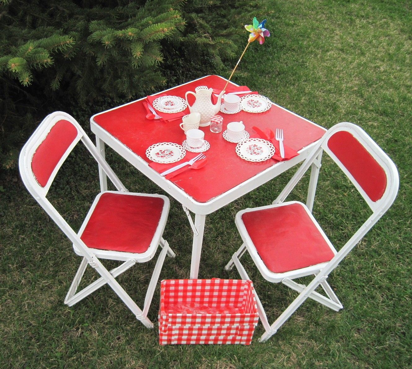 hosted many tea parties with my plastic dishes on my red and white table set