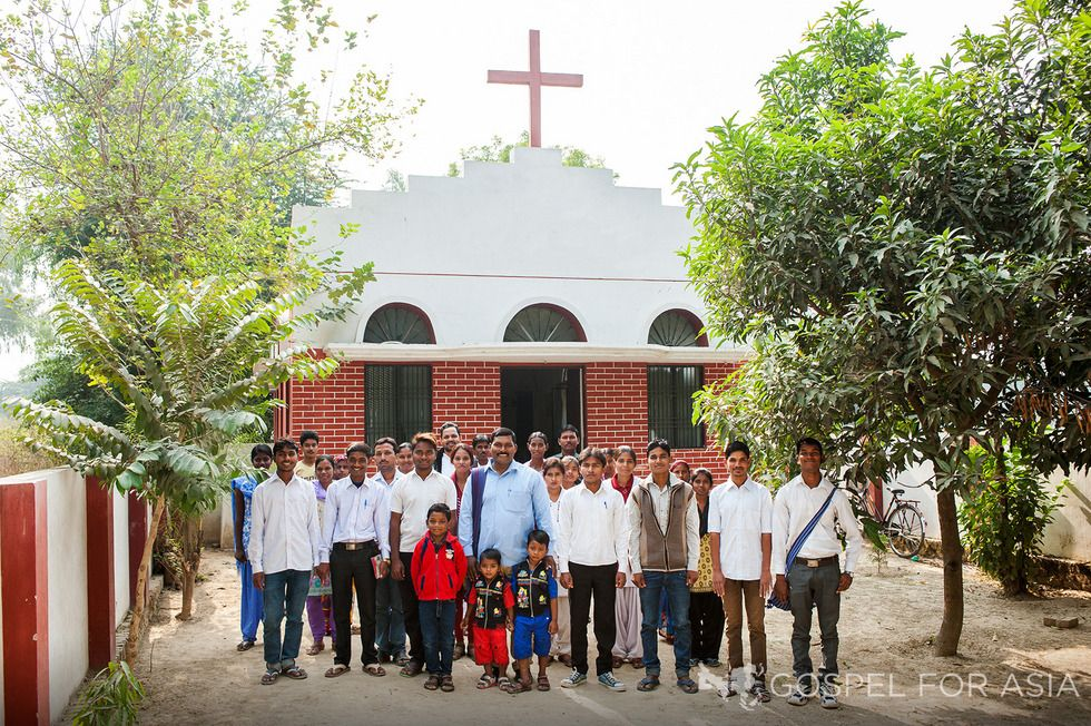 Blessed with the shelter of a physical church building, these believers are able to praise God together in one place.