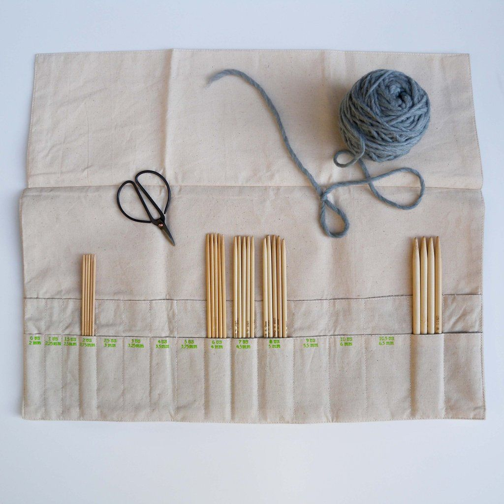 """Keep all your double point needles organized and within arm's reach with this beautiful, natural cotton case. There are two rows, each with 14 numbered pockets to hold needles both US and metric sizes 0-10.5 (2-6.5). An additional 4 pockets accommodate larger size needles. Sizes are printed onto the case, with matching tie closure. When open, the case measures 16"""" x 10.25"""". Closed, the case is 10.25"""" high."""