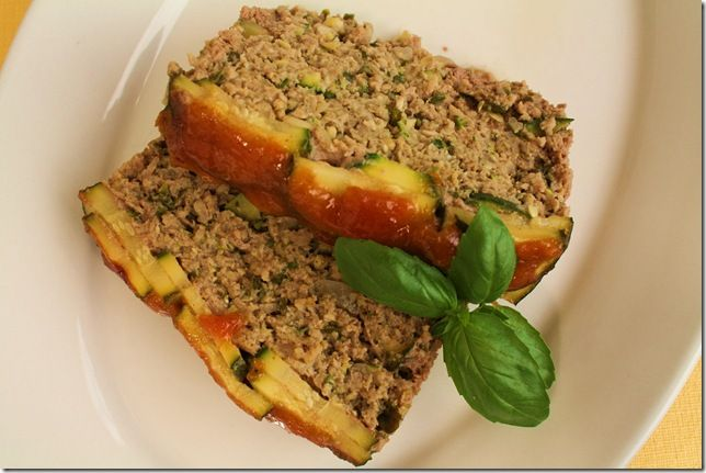 beef and zucchini meatloaf photo by vsimon Are you playing ring and run, leaving sacks of zucchini on your neighbor's porch yet? When they ripen in the garden, it seems like they grow 5 inches a da…
