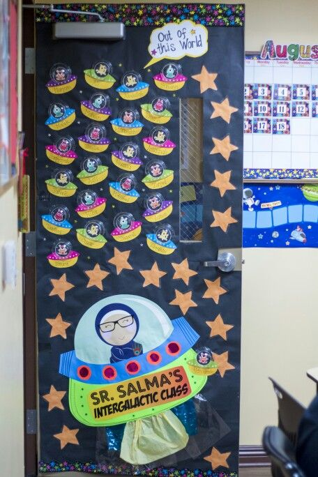 Space themed classroom door! The alien ships were made using clear dome cup covers and hot glued in place.