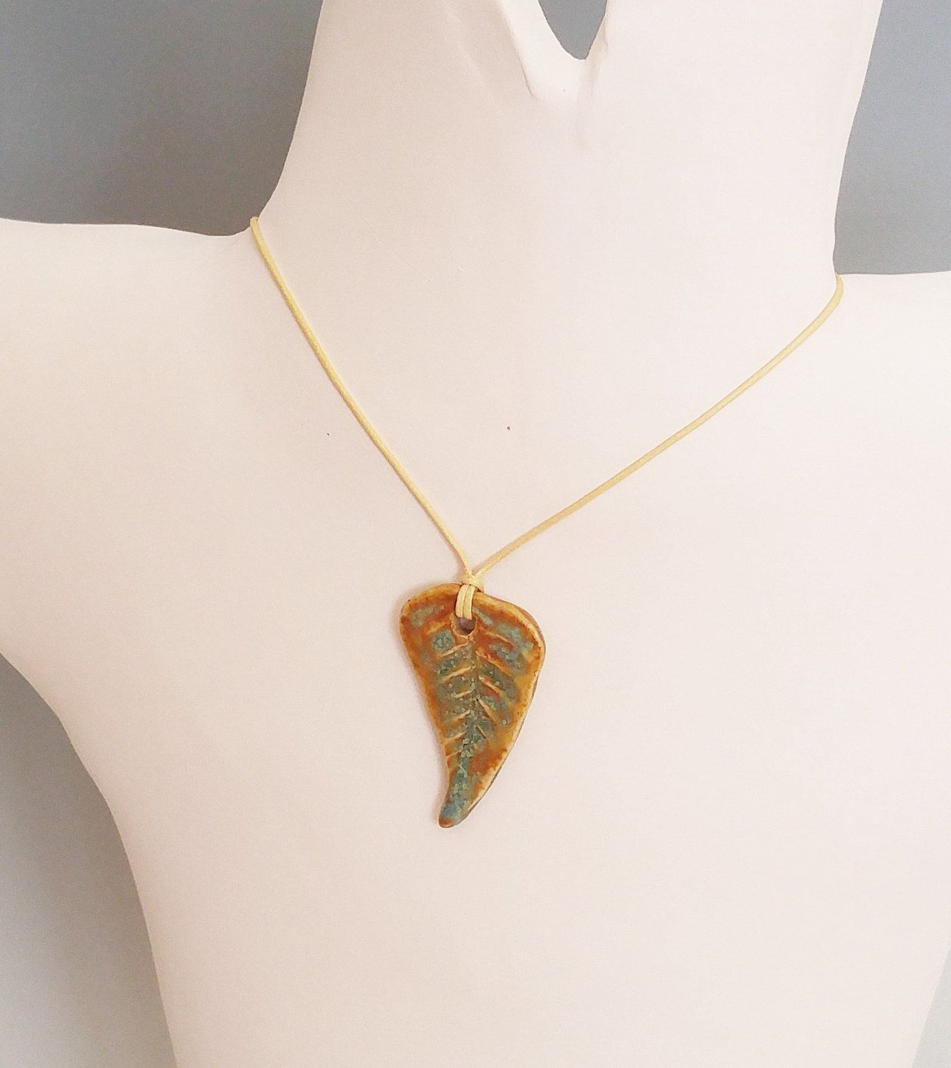 Make a fashion statement with this ceramic fern pendant necklace make a fashion statement with this ceramic fern pendant necklace save money when you like or pin i handmade this ceramic pendant from stoneware clay mozeypictures Gallery
