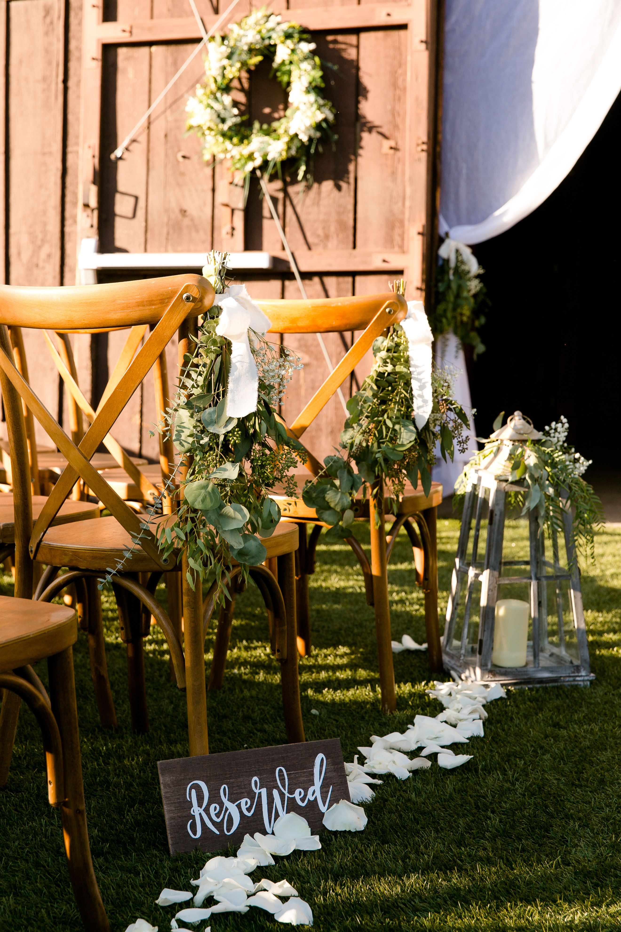 Barn ceremony site eucalyptus floral accents Ethereal