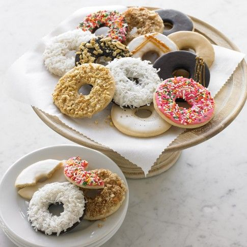 Doughnut Cookies in traditional flavors/toppings: vanilla, chocolate, coconut; peanut w/ chocolate icing; peanut w/ peanut icing & peanuts; banana w/ peanut icing; banana w/ vanilla icing & caramel