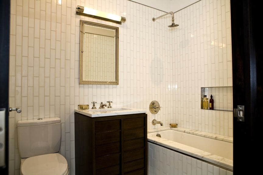 Whoa. VERTICAL subway tile? What, what? Super cool. Excuse me while on
