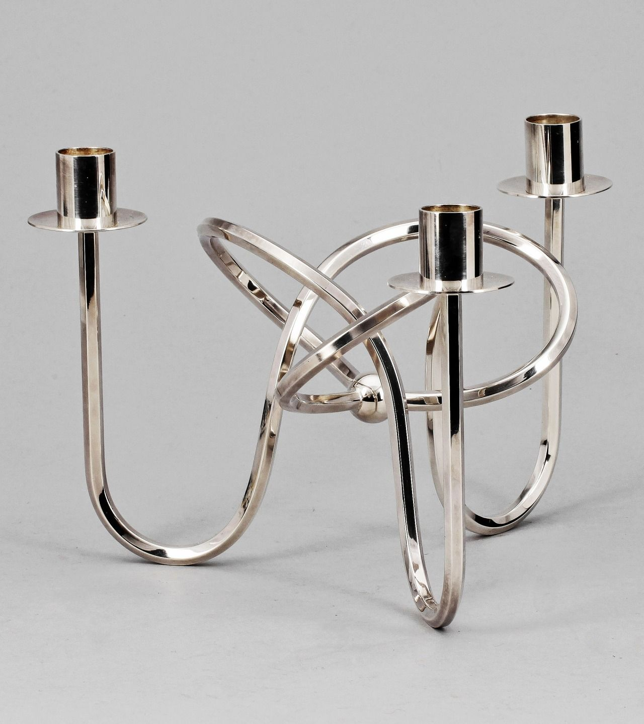 JOSEF FRANK, Vänskapsknuten candel holder, 1938. Designed for and manufactured by Firma Svenskt Tenn Ab, Sweden. Silver plated brass.