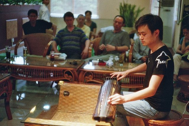The Guqin ( 古琴 gǔqín ) is a plucked seven-string Chinese musical instrument of the zither family.