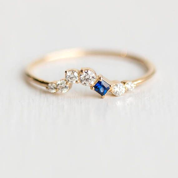 All Who Wander Ring in Sapphire Curved Diamond Cluster and Blue