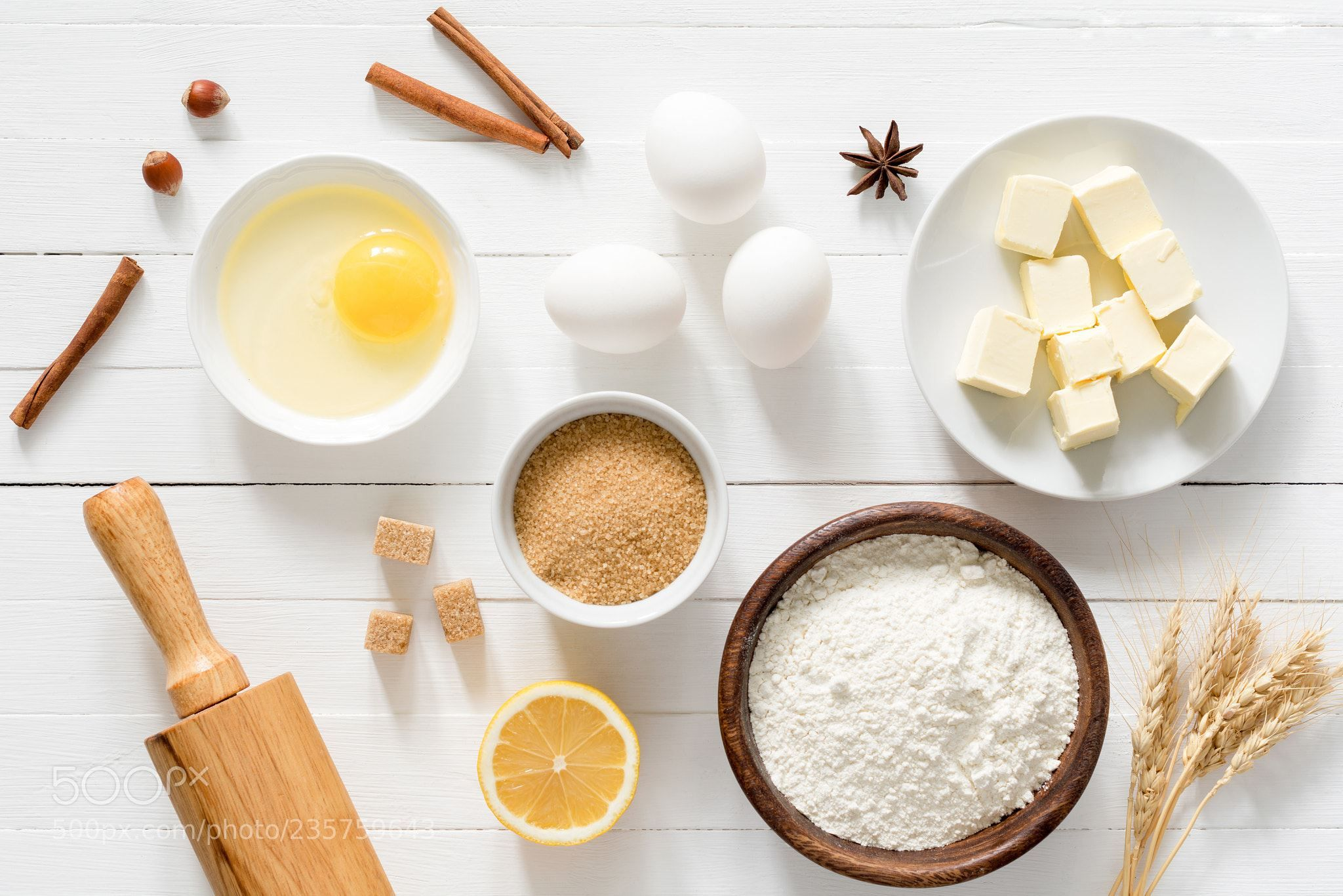 White Table Top View. Perfect Top Baking Ingredients And Kitchen Utensils  On White Wooden Table