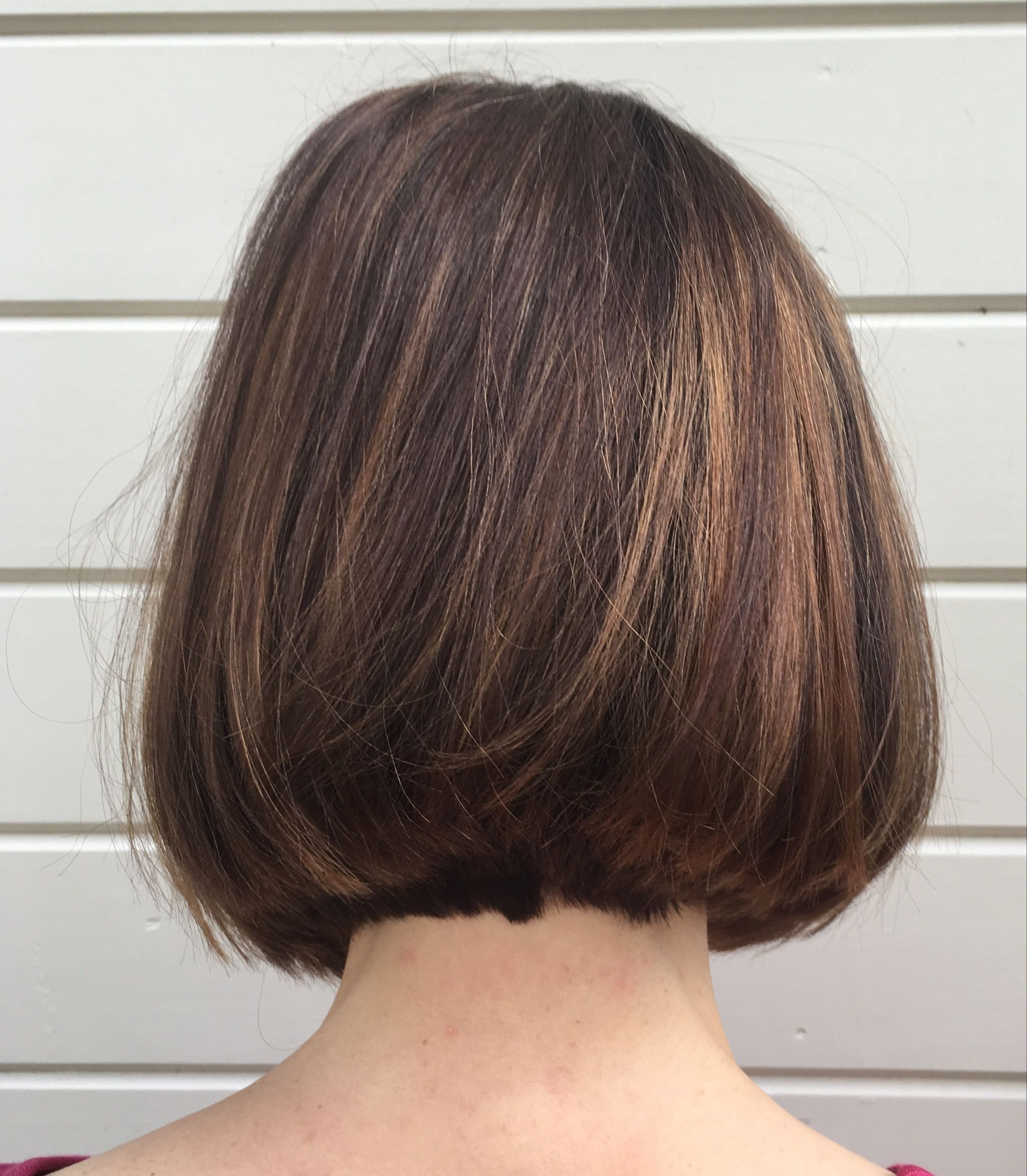 Rich dimensional brown hair accented with different tones of copper