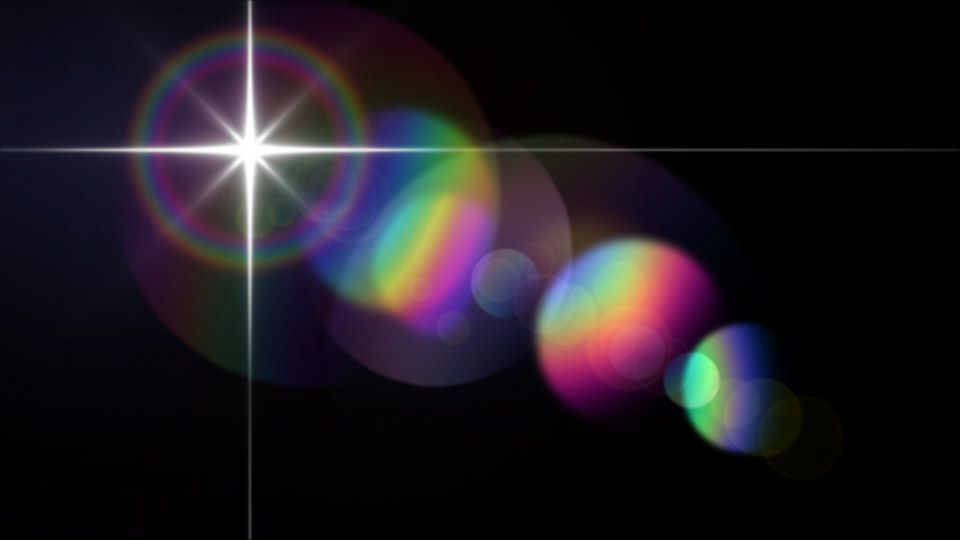 Rainbow Colored Lens Flare Effect On Black Created With Creation