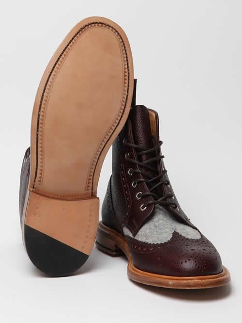 Woolrich Woolen Mills Para Boots.The English-made Derby wingtip-brogue boot features an upper that's mixed with Melton wool and full-grain leather, a stacked wooden heel and a Goodyear-welt sole.