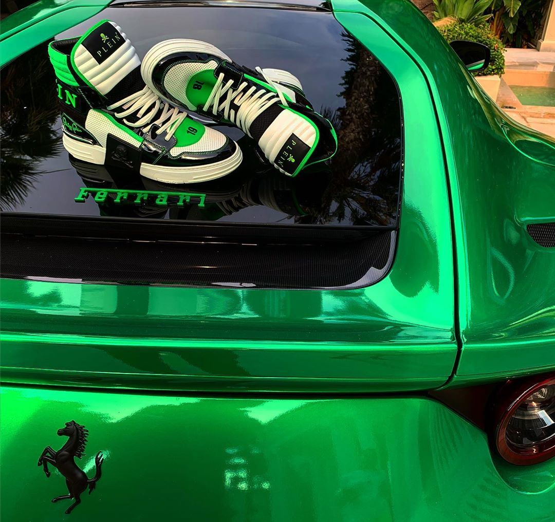 Designer posts image of sneakers on his own Ferrari, gets