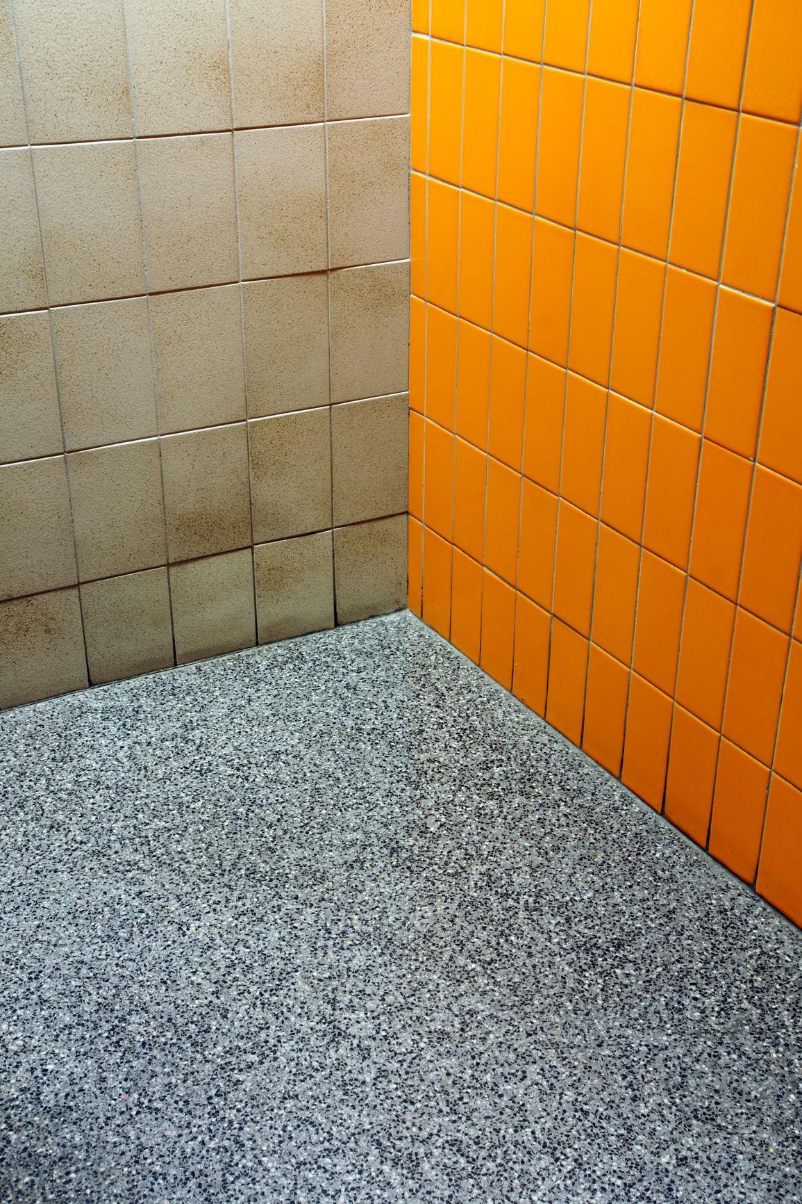 Corner of a public bathroom where three different