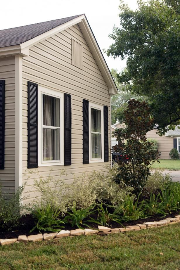 Hgtv Take A Peek At This Freshly Updated Exterior With Neutral Siding Black Shutters And New