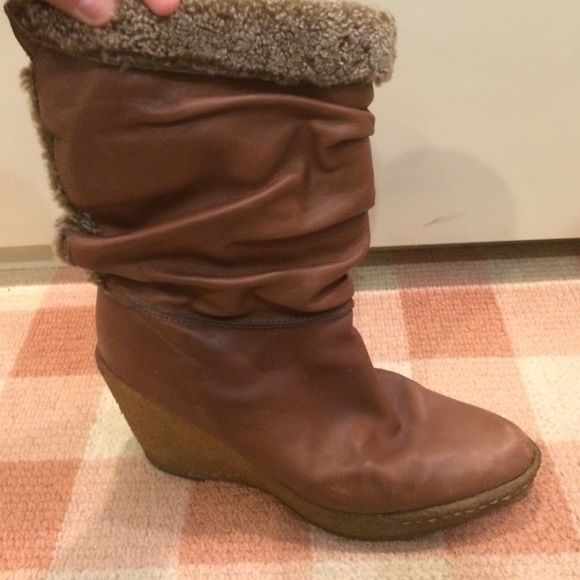 Stuart weitzman tan wedge boots Stuart weitzman tan wedge boots, scoffs on the wedge part and at tip of toes, size 8, easy to walk in Stuart Weitzman Shoes Wedges