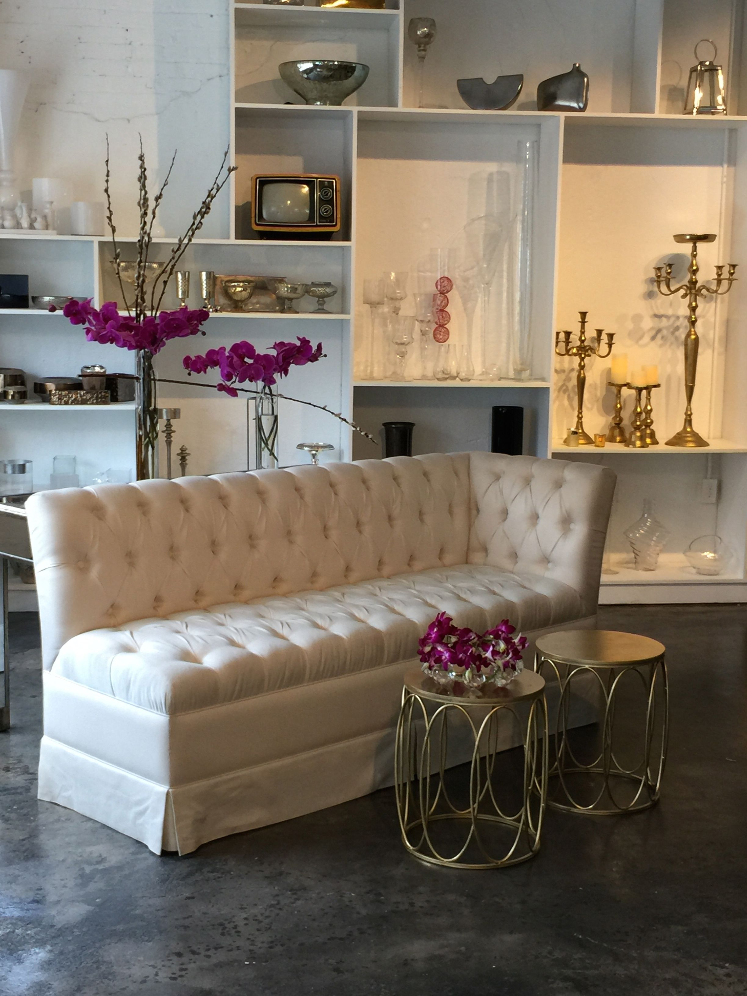 Cream tufted couch, sectional, golden coffee tables for