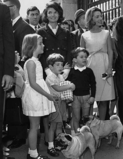 Jackie and Lee, with their children and dogs, outside Buckingham Palace.