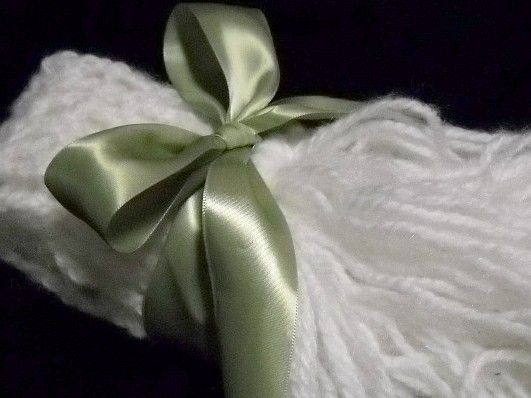 Extra long, white crocheted scarf.  Goes with anything, warm & cozy.  $27.00