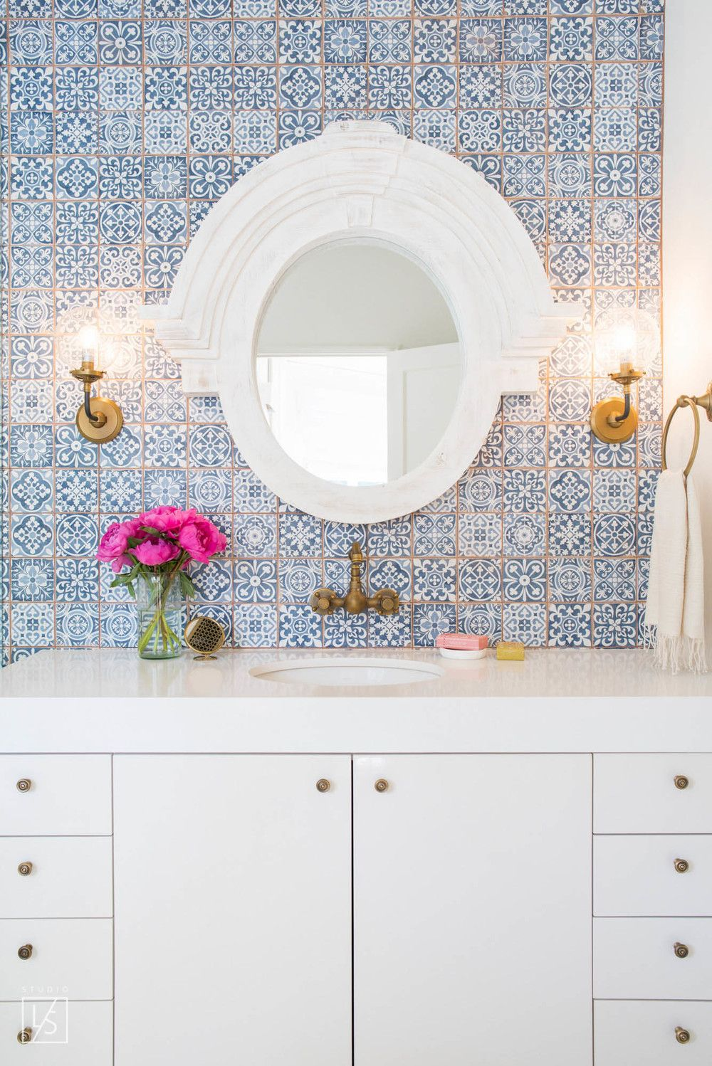 Small bathroom with gorgeous blue tiles and gold grout. White vanity ...