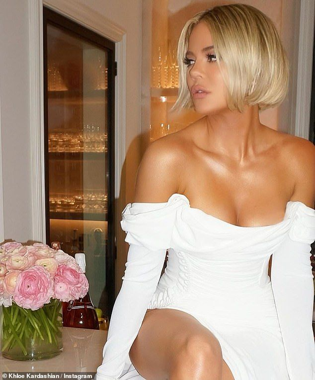 Khloé Kardashian is a vision in a white off-the-shoulder dress