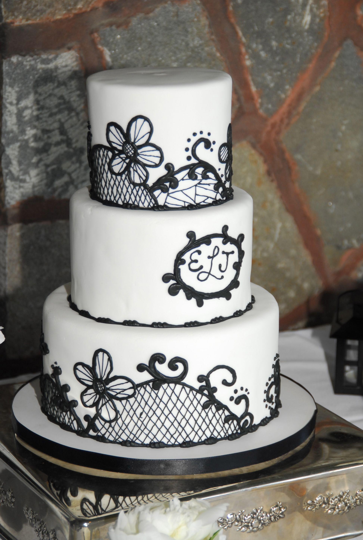 Black and white elegant wedding cake scroll work
