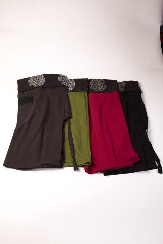 Harem Pants Men, Buddha Pants, Hippie Clothes, Yoga Pants For Men's, Tribal Pants, Burning Man Shorts, Men's Clothing Wrap Style Drop Crotch is part of Hippie Clothes Mens - Harem Pants Men, Buddha Pants, Hippie Clothes, Yoga Pants For Men's, Tribal Pants, Burning Man Shorts, Men's Clothing Wrap Style Drop Crotch These  wrap style  pants are lightweight, comfortable, and  flowy  shorts for men   A wonderful alternative to your regular yoga shorts, or just so amazingly comfortable to wear around the house or out to casual events  These are one size fits all  natural wrap  and tie shorts  Popular with Yogi's, Message Therapists, and any other activities that require a free range of motion  Sizing (one size fits almost all) Waist 28in44in Length 26in Item ships in 13 business days!We are proud to introduce you extremely high quality handmade Thai clothing, which perfectly fit to your festival, beach, yoga, cruise, summer vacation or just new addition to your wardrobe that will inspire you for your new street look!  The comfort that this clothing will provide you can't compare to the most similar clothing that you can find! Please keep in mind, buying from High Thai this  Sizing of our clothing is correct for US not Thai  Many of the other similar clothing is thai sizes and its way off  Then when you have to return you have to send it all the way back to Thailand and you have to wait 46 weeks to get a refund   Shipping time is usually 35 days, not 46 weeks as usually other similar clothing is   Quality  many of the items there fall apart after a few washes  Since I control the fabrics and know who makes my clothing by hand, not a big factory, I know that my clothing holds up better and I use higher quality fabrics only! This is hard to see in the pictures but it is true  When I go to Thailand I see a lot of other similar very cheap pants but they are not the same quality and they do not feel so comfortable like mine do!   Return time  I can exchange or return quickly and I have great customer service with this  You can read reviews on Etsy!  My Mission is to share the thrill and excitement of entering the Thai culture for the first time with all of our customers  This philosophy was employed as I personally hand selected each and every unique item that I sell  Our handmade items adhere to Fair Trade principles, we deal with the family and village based groups that produce these items, this ensures that the wealth generated by the labor involved goes directly to the people who create them  North Thailand does not suffer from the factories and sweatshops that are prevalent in Bangkok and other Asian centers, we are proud to be a part of this cottage based industry and to support the artists who create these beautiful pieces  Through these purchasing techniques, I am able to perpetuate the artist's ability to continue producing these inspiring fabrics that allow me to create such a unique brand