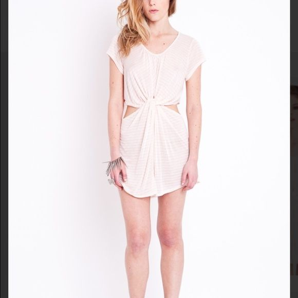 Ark &Co white peach twist dress from Nasty Gal (M) Ark &Co white peach twist dress from Nasty Gal (M). Short fit. I wore this item mostly as a shirt and am 5'6. Great condition. Original retail $58. 65 % polyester 35% cotton. Ark & Co Tops Tees - Short Sleeve