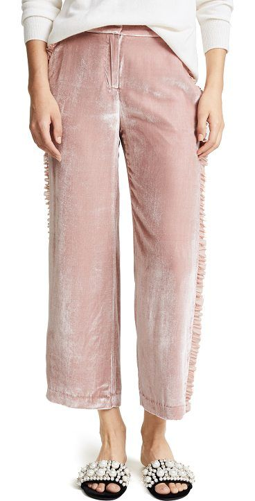 zoma pants by Cinq A Sept. Luxurious velvet Cinq a Sept cropped trousers in a high-rise silhouette. Dainty, flounced ruffles trim the side seams...