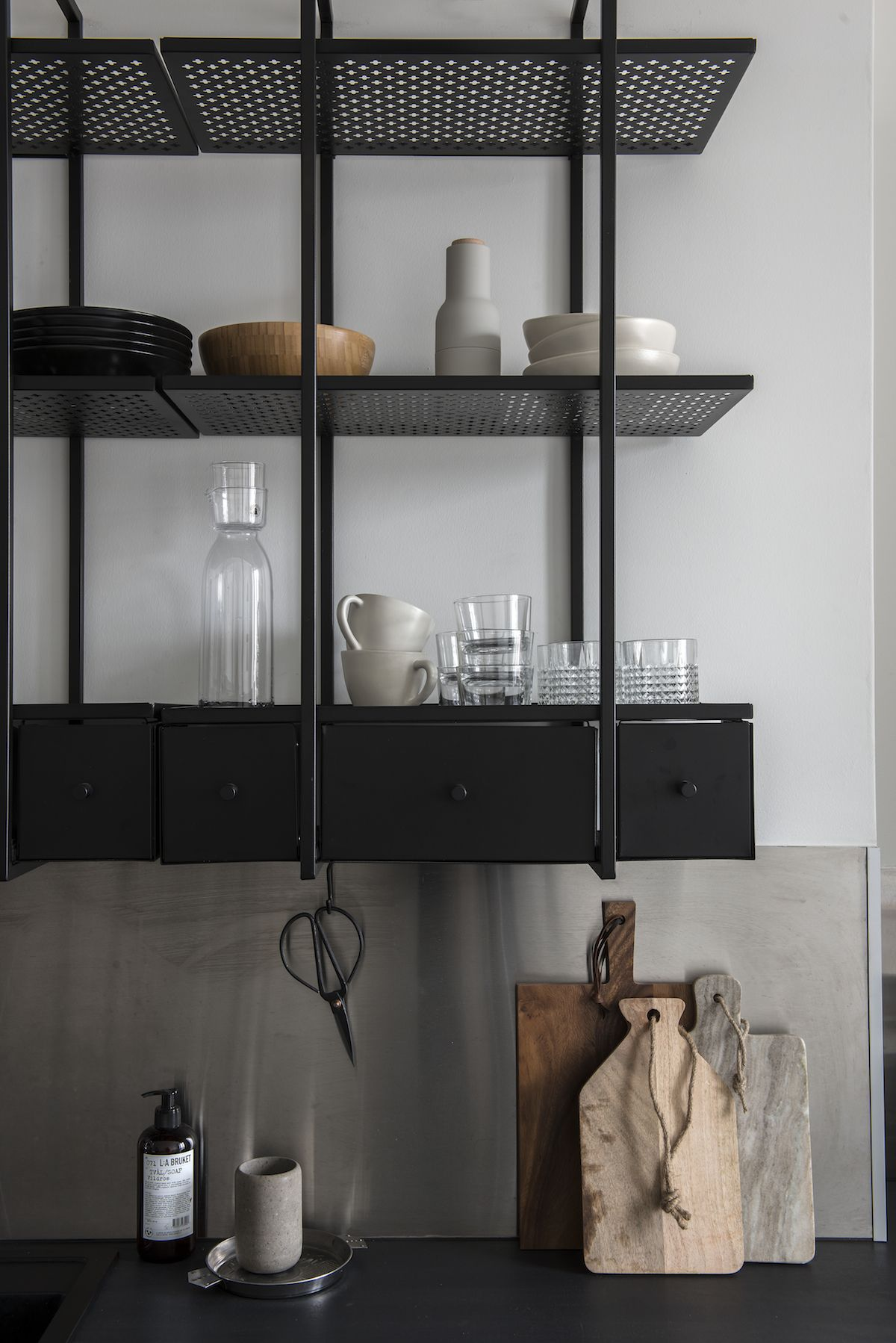 Unusual black metal shelves in the kitchen | open shelving | black kitchen  storage | kitchen styling | Beautiful Helsinki Home - via Coco Lapine Design
