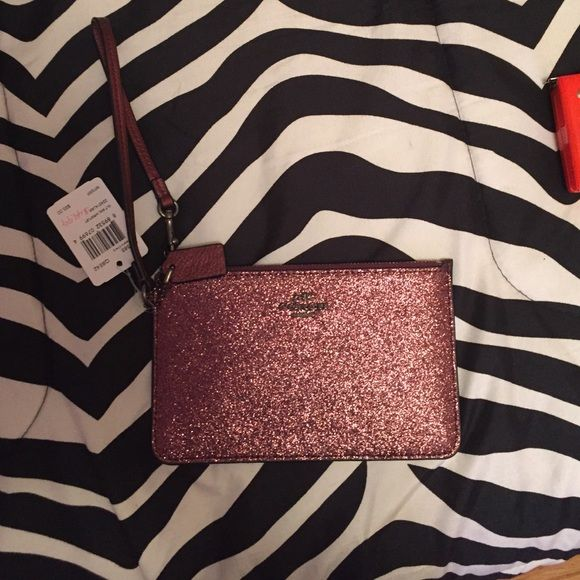 Coach Wristlet Metallic Brand new with tags Coach metallic pink wristlet.  So cute and dresses up any outfit. Has two card slots on the inside of the front portion of the wristlet. Coach Bags Clutches & Wristlets