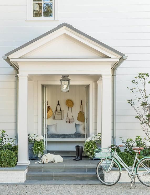 Cottage Home Features A Steps Up To A Portico Filled With French
