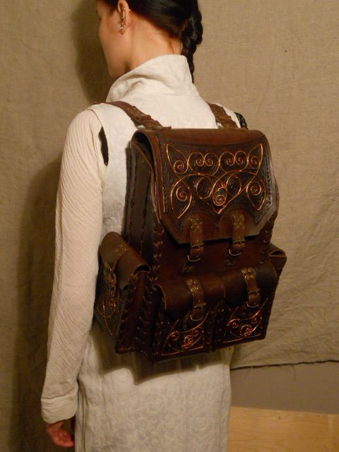 A leather backpack with copper ornament by ChanceZero.deviantart.com on @deviantART