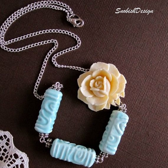 "Handmade adorable flower necklace with a sweet vintage ivory blooming flower pendant, baby blue ceramic beads, Bali silver spacer beads on each end of the ceramic beads, silver chain, and lobster clasp for closure at the back of the neck.    Length: Approx. 10.5"" long"