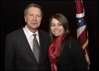 trafficking18p 1-6 Elizabeth Ranade-Janis, with Ohio Gov. John Kasich after a December Chamber of Commerce meeting, is Ohio's first coordinator against human trafficking.