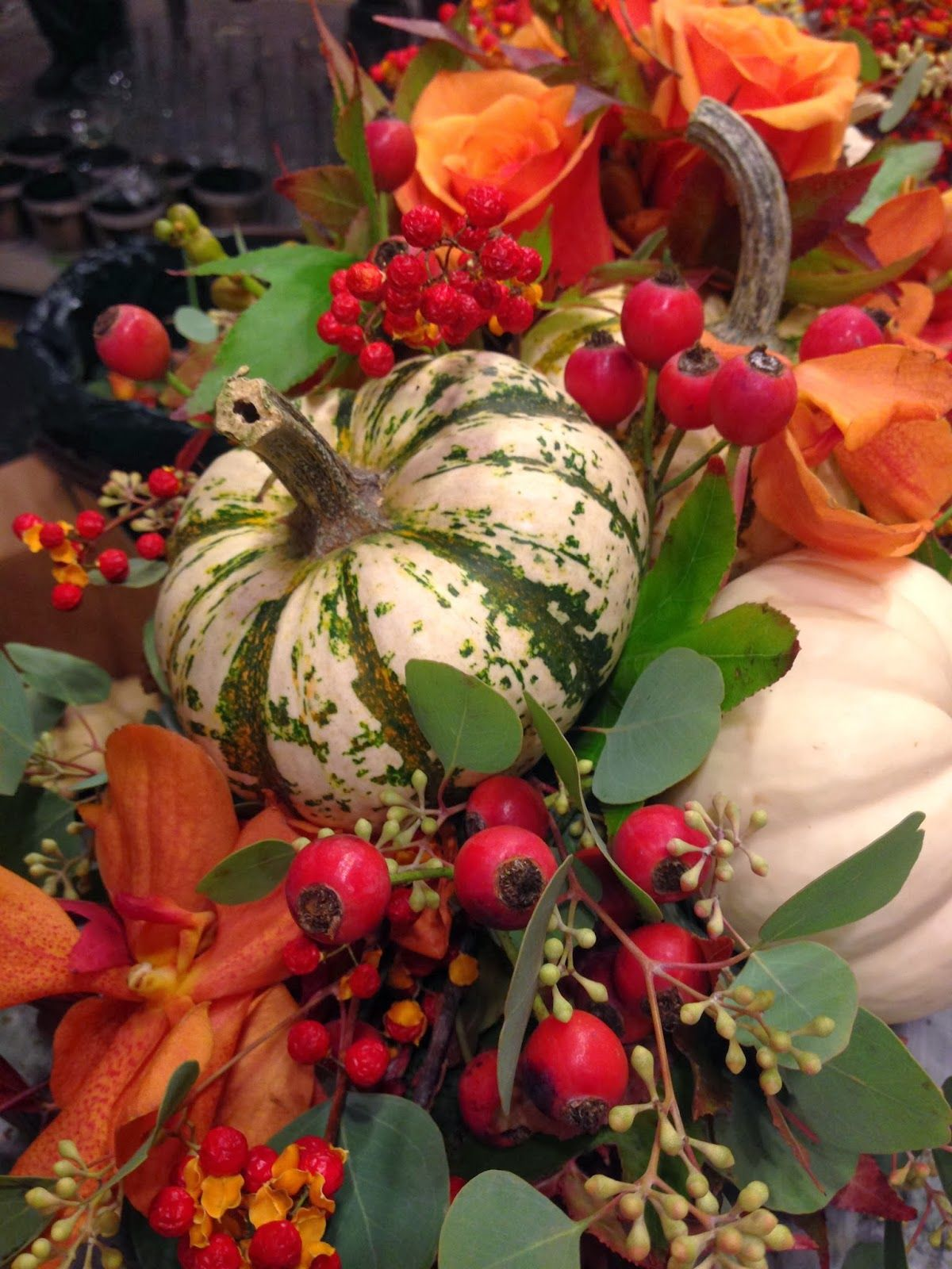 Fall arrangement use of variegated gourds or pumpkins