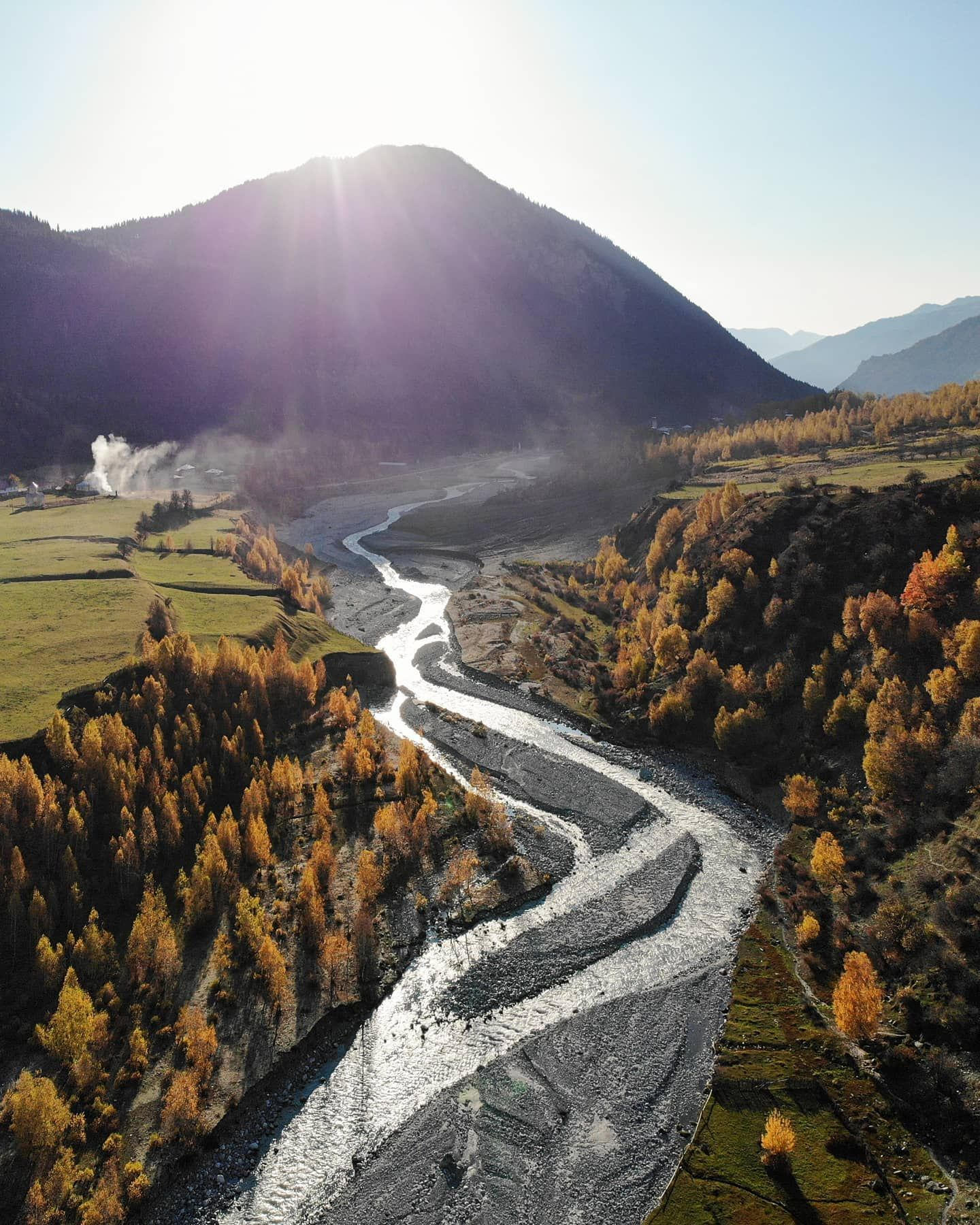 Georgian Autumn  . Just when we arrived at the small village of Zhabeshi I sent the drone up to catch the sunset light over the Georgian moutains. The astonishing colors of autumn were accompanied by a swirly stream of cold water. The water originates from the glacier Tsaneri about 7km upstream. .  DJI Mavic Air  Zhabeshi Georgia  27th of October 2019 . . . . . . . . @dji_official @djiglobal @natgeotravel @lexarmemory @ourfotoworld  @georgiatravel @wizzair @natgeoyourshot @natgeonl @eclectic_sho