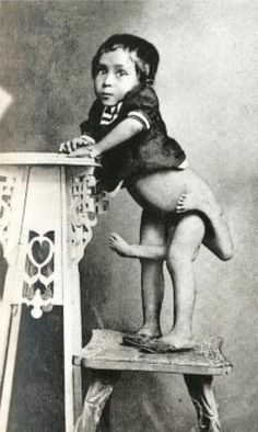 Circus Freaks of the Past.  I am not sure where the person ends and the costume begins.