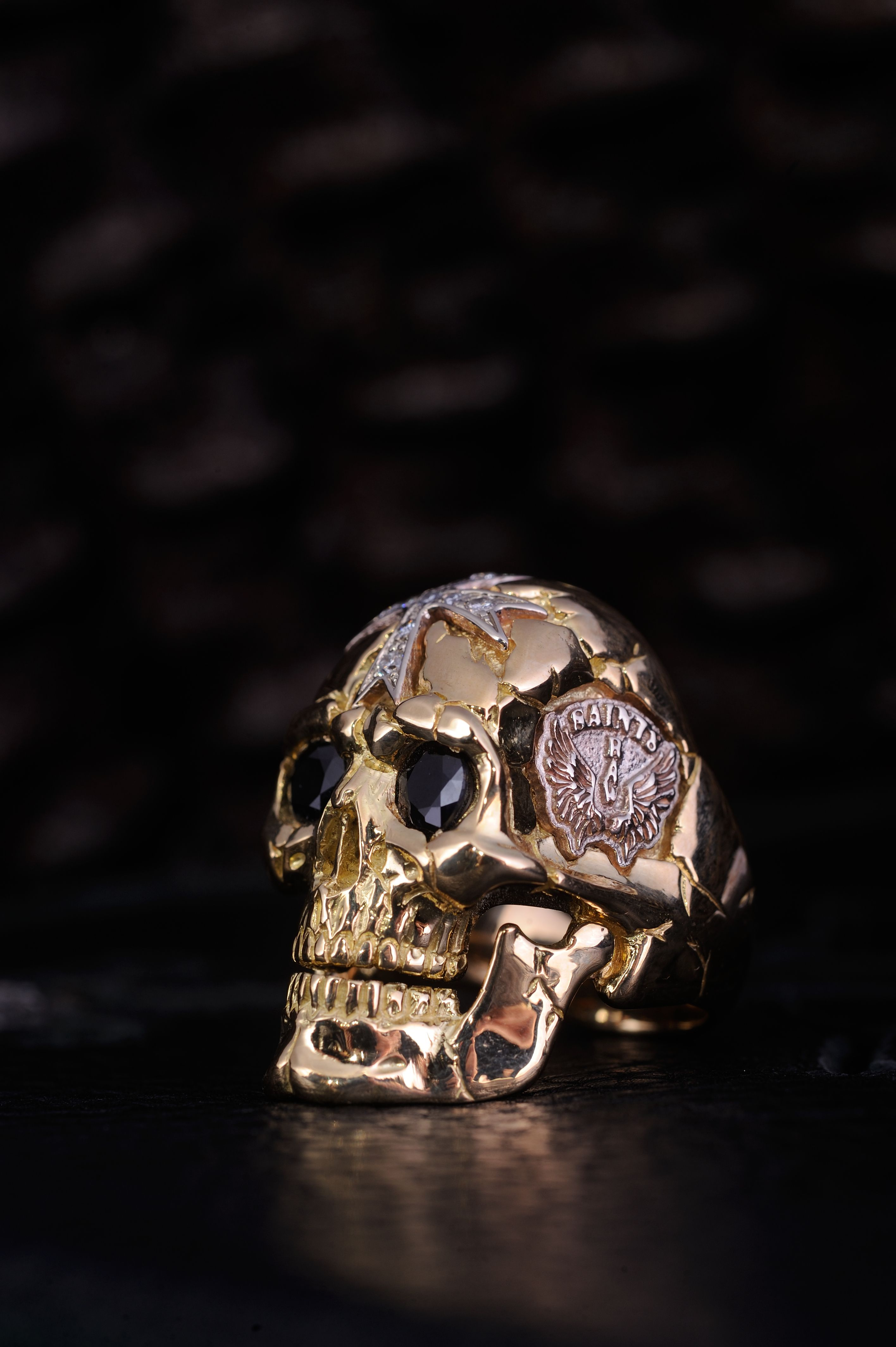 Solid 18K gold skull ring with large sapphire eyes
